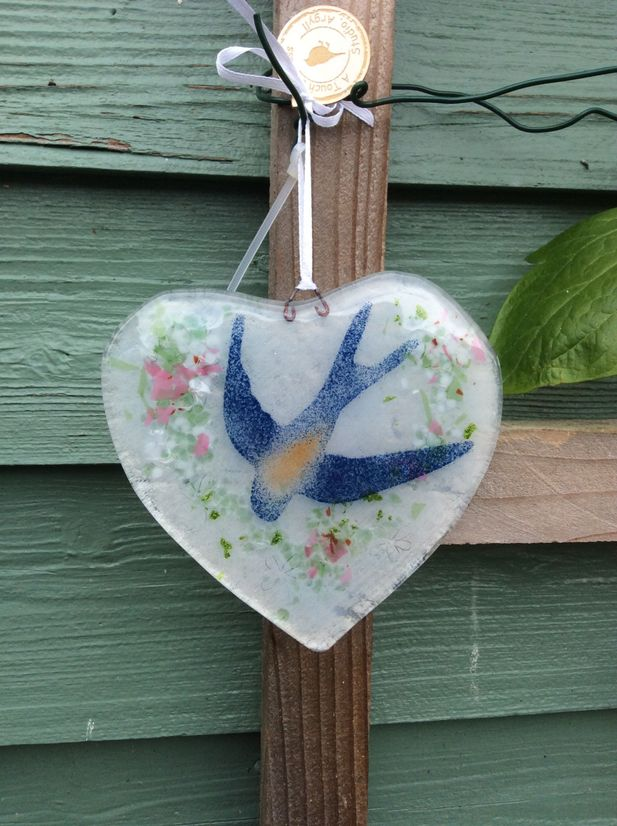 Handmade fused glass heart with Swallow detail.